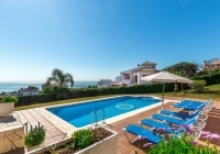 View of the swimming pool and sun loungers