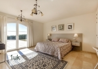 Master bedroom with large windows to all natural light