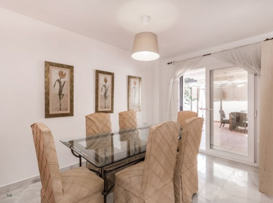 Glass dining table with cream chairs