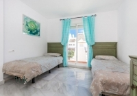 White and light blue interior inside twin bedroom