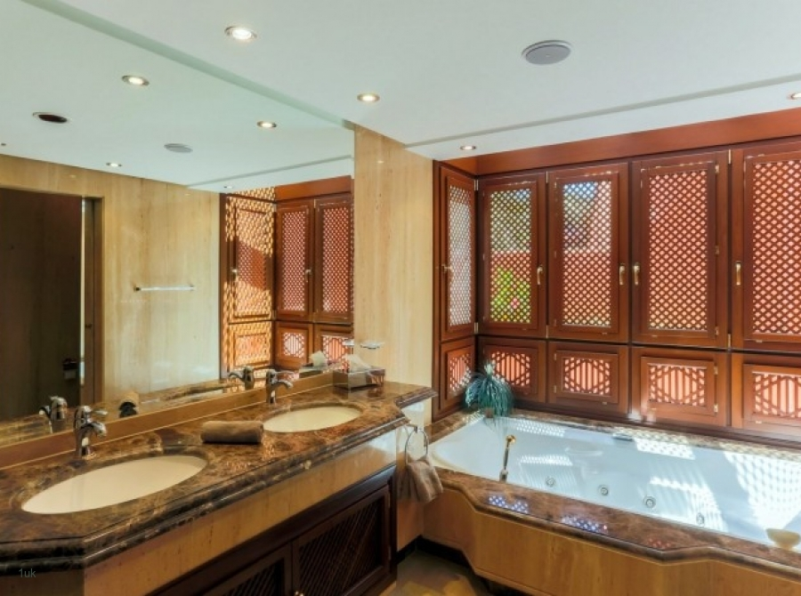 Large bathroom with two sinks and a bath
