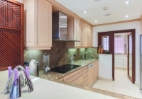 Kitchen with cooker and storage