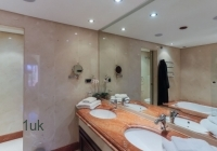 Bathroom with mirror and sink