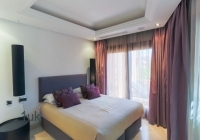 Bedroom one with large window and great view