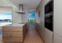 Fitted cupboards and appliances in the kitchen
