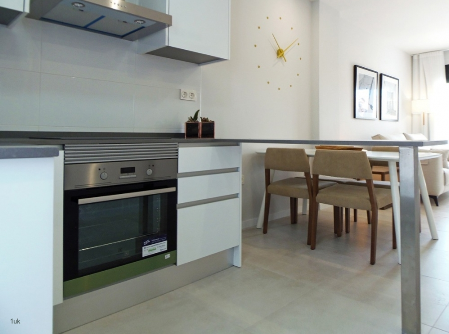 Cooker in the kitchen with dining table