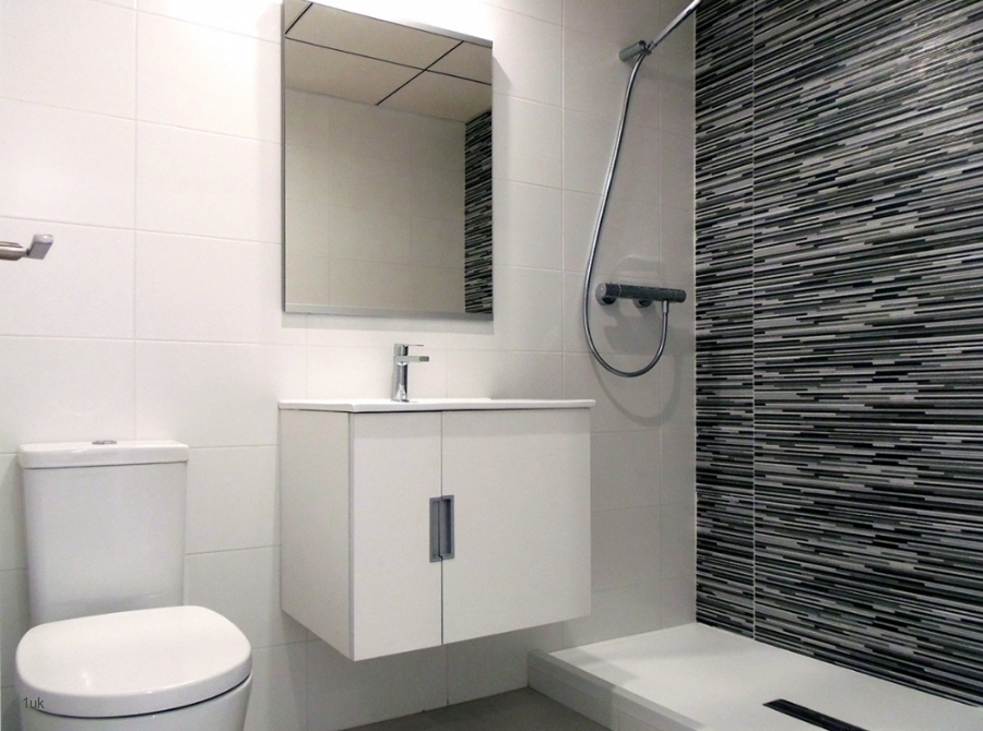 Shower, toilet and sink with light up mirror