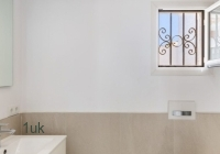Sink with small window in the bathroom