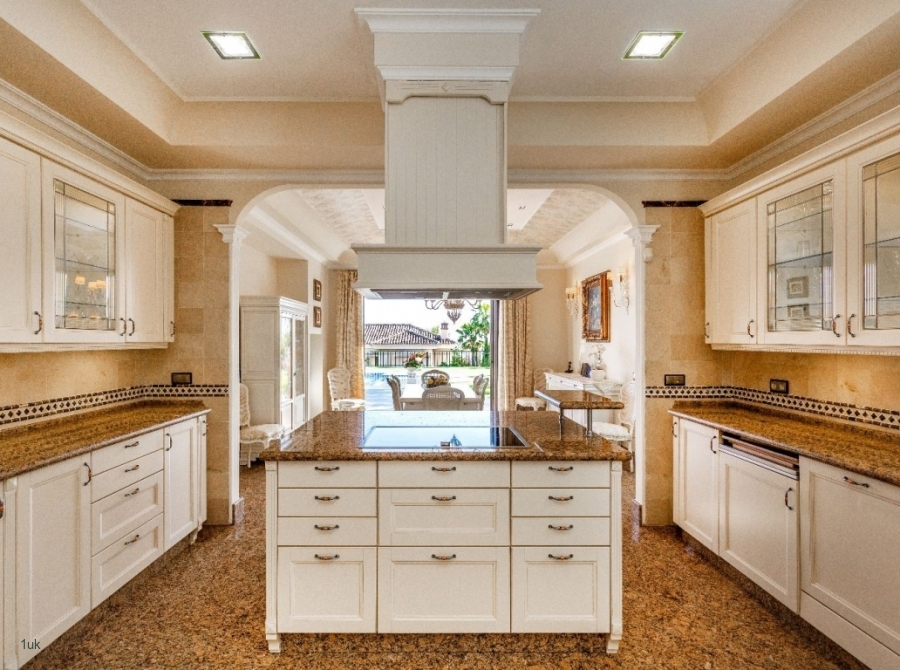 The kitchen with built in cupboards