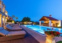 Lounge chairs besides the pool
