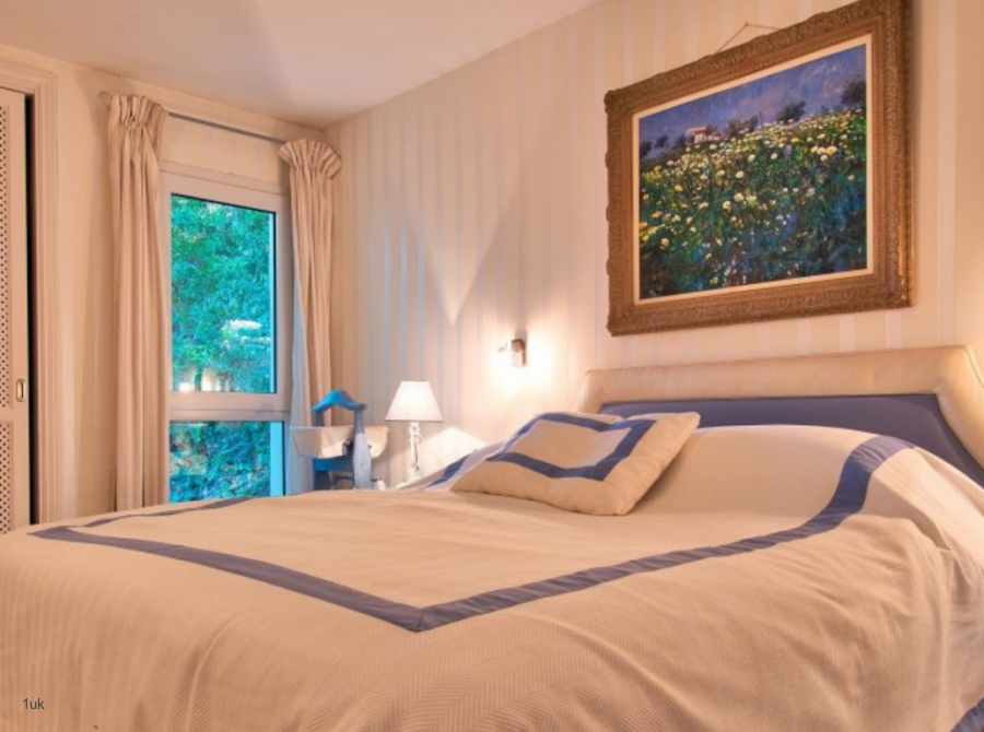 White and pale blue bedding in the master bedroom