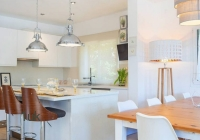 White kitchen and dining area in Mallorca