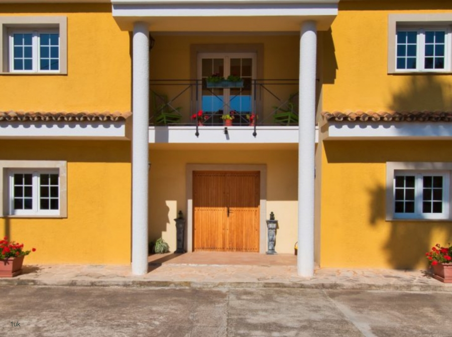 Charming Villa for Sale with yellow bric work in Port Andratx