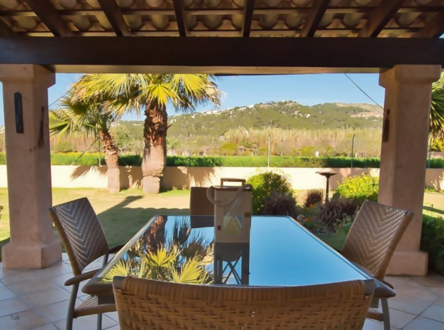 Terrace at the property with views of the gardens surrounding