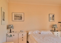 Spacious magnolia bedroom with double bed