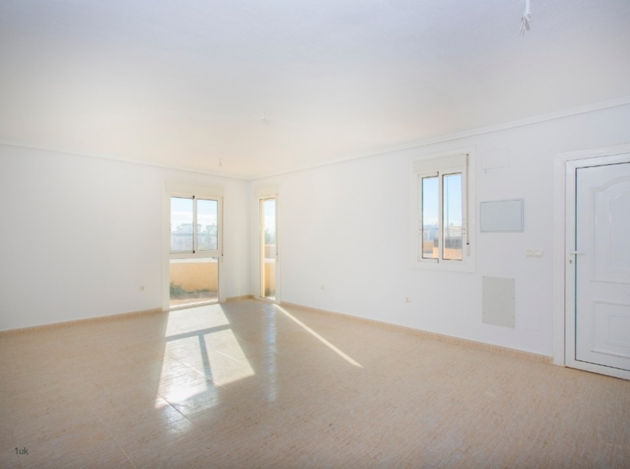 Large open plan living room with white washed walls