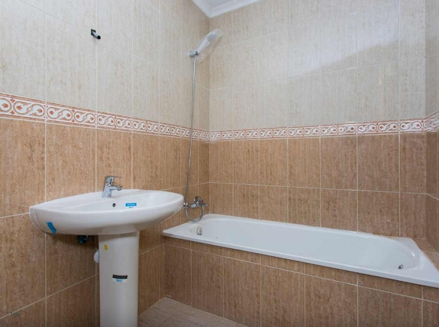 Large clean bathroom with shower, sink and bath tub