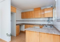 Inside of the modern looking kitchen with storage cupboards