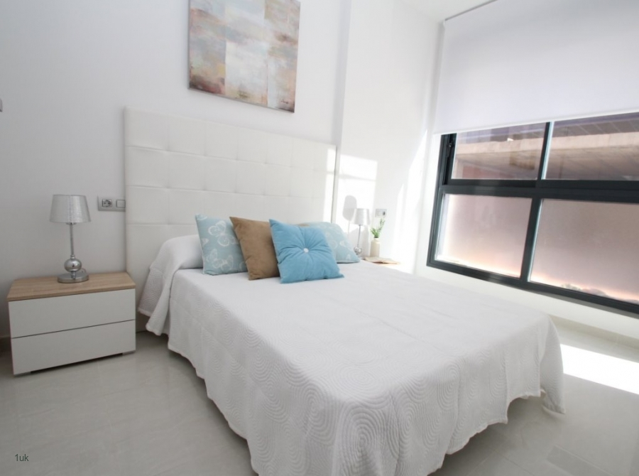 Bright white and light blue interior with large black frame windows.