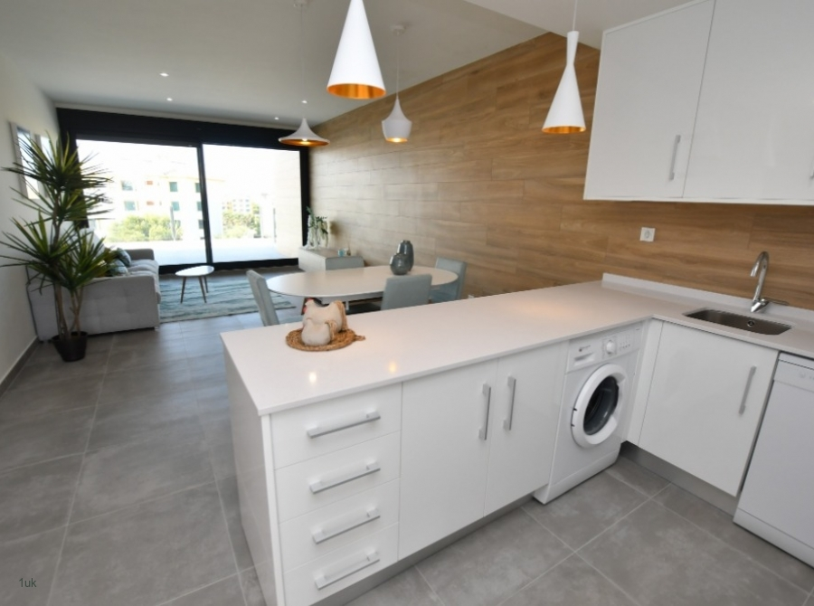 Full view of kitchen with cupboard storage and washer