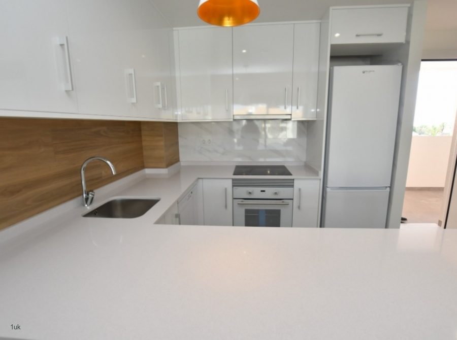 Large white L shaped worktop