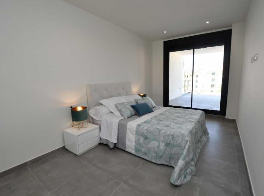 Master bedroom with large windows for amazing sea views