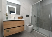 Shower cubical with toilet and two draw storage