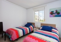 Twin room in beedroom with bright interior