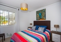 Double bedroom with bright bedding