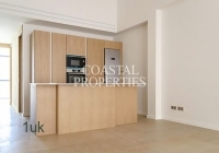 Small kitchen with built in appliances such as cooker and oven