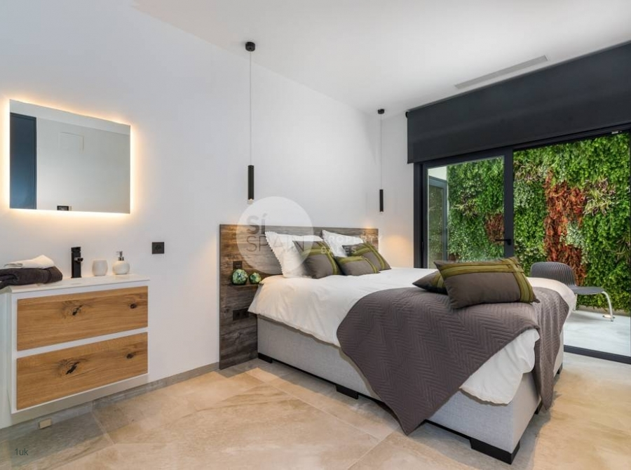 Spacious master bedroom with large windows and electric blinds