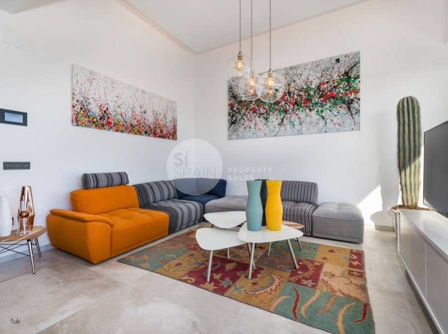 Orange and grey sofa in the lounge area