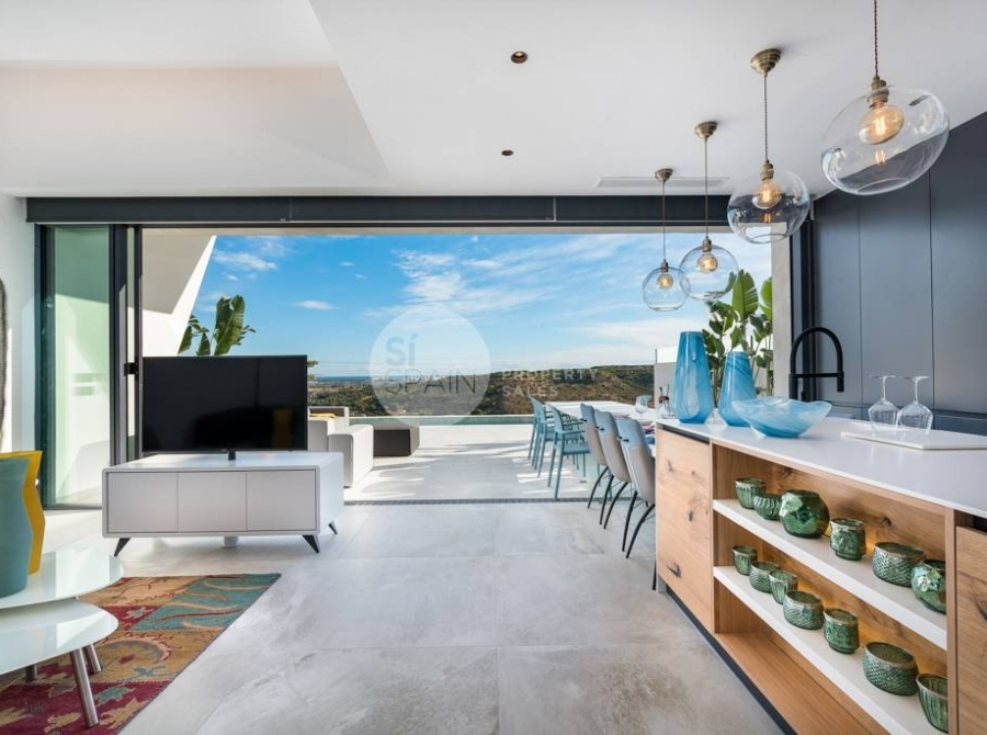 Large bi-folding windows leading from the lounge to the infinity pool
