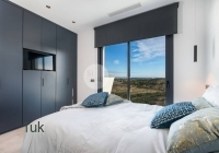 Beautiful grey and white bedroom with fitted wardrobes and TV