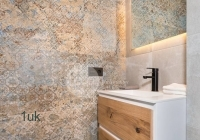 Beautiful bathroom features including sink and light up mirror
