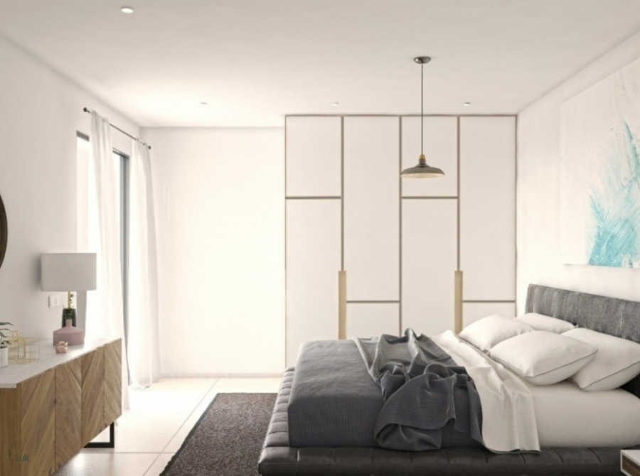 Guest bedroom with large bed and fitted wardorbes