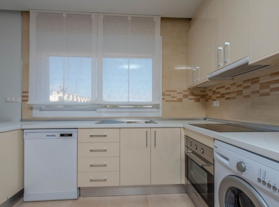 Spacious kitchen with oven, washer and dishwasher
