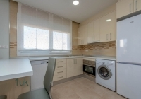 Spacious kitchen with modern fitted appliances