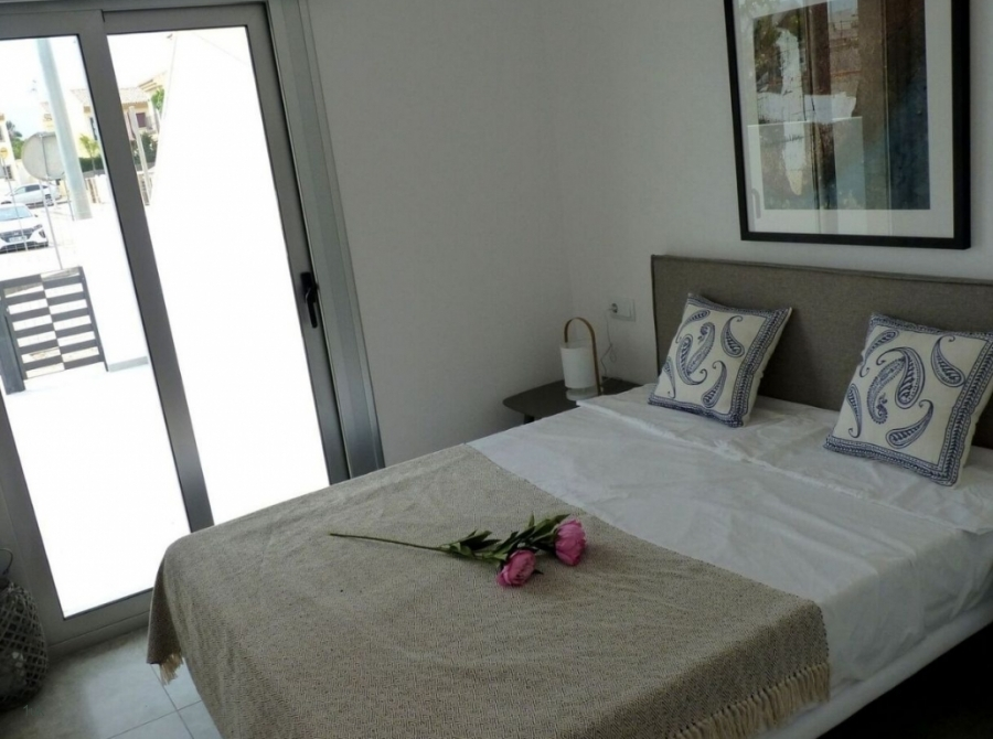 Master bedroom with large glass sliding doors