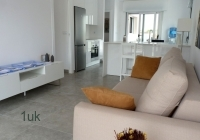 Well presented grey and white spacious lounge
