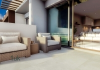 Two cushioned chairs on the terrace